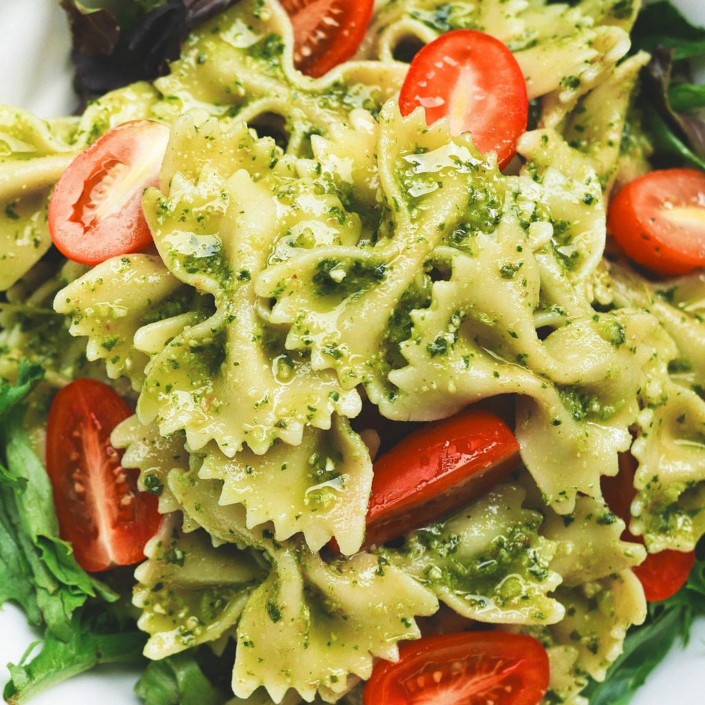 Pasta with pesto sauce and tomatoes